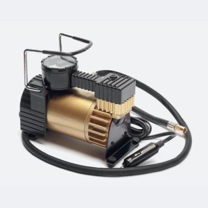 Car air compressor with manometer isolated on a white background
